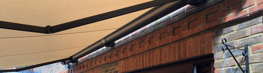 Underside view of brown patio awning