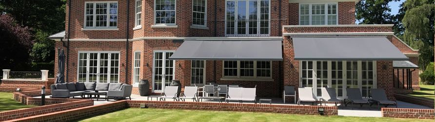 Large House with double patio awnings in Surrey